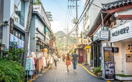 Seoul Korea , 23 September 2019 : Pedestrian street with Asian couple and mount Inwangsan in background in Bukchon village district Seoul South Korea