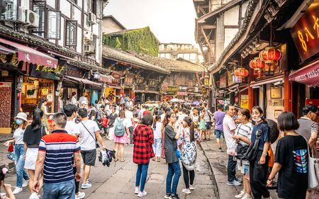 Chongqing China, 7 August 2019 : Ciqikou alley full of people with old houses and shops in Chongqing China