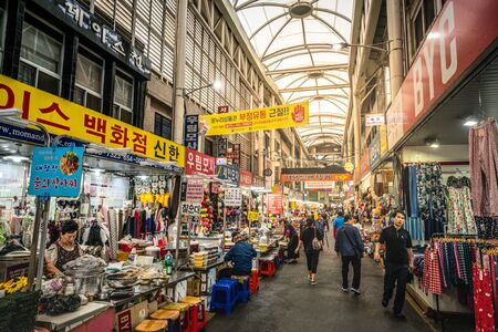 Daegu Korea, 1 October 2019 : Daegu Seomun covered market during daytime alley view with food and clothes stalls and people in Daegu South Korea