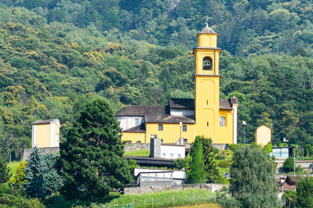 View of San Sebastian yellow church in Bellinzona Ticino Switzerland