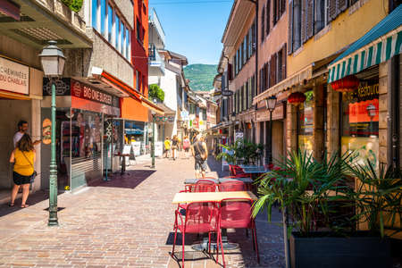 Aigle Switzerland, 4 July 2020: Pedestrian street view with restaurants and people on sunny summer day in Aigle Vaud Switzerland