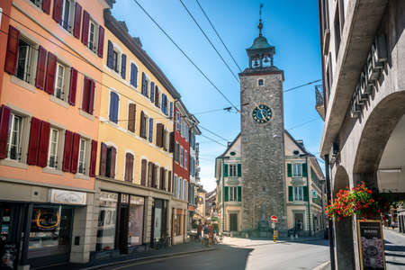 Vevey Switzerland, 4 July 2020: Vevey street view with old colorful buildings and clock tower in the historic center in Vevey Vaud Switzerland 新闻类图片