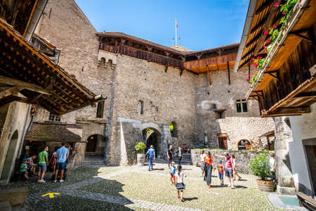 Veytaux Switzerland, 4 July 2020: Tourists in a courtyard inside Chillon Castle in Switzerland