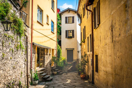 Gandria village scenic laneway with colorful houses and dramatic light in Gandria Lugano Switzerland