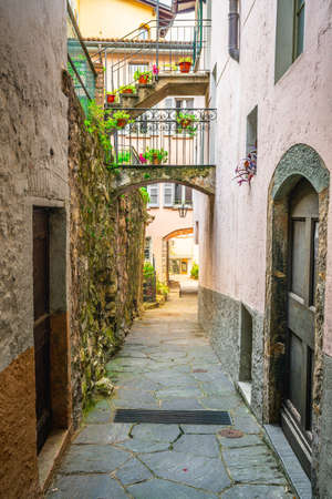 Gandria village alley vertical view with colorful houses in Gandria Lugano Ticino Switzerland