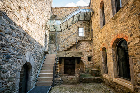 Courtyard and entrance of museum in middle of Montebello castle church in Bellinzona Ticino Switzerland