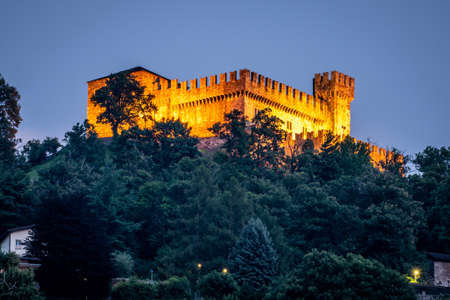 Distant view of Sasso Corbaro medieval castle illuminated at night in Bellinzona Ticino Switzerland 新闻类图片