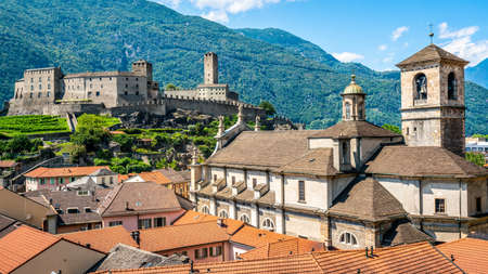 Scenic cityscape of Bellinzona with Castelgrande castle and Chiesa Collegiata dei Santi Pietro e Stefano church in Ticino Switzerland