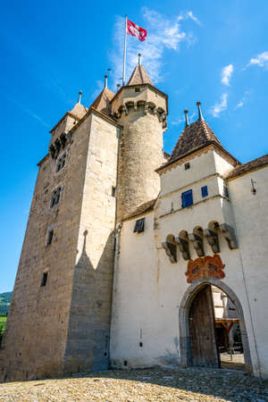 Vertical view of entrance gate and tower of Aigle castle in Vaud Switzerland