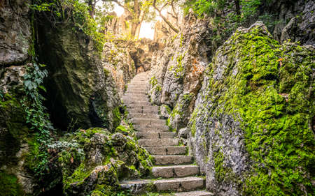 Stairs pathway in middle of limestone rock formation and dramatic light at Shilin stone forest park in Yunnan China