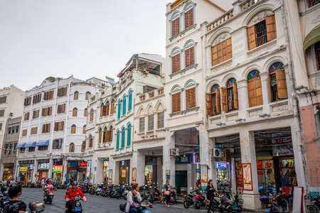 Haikou China, 21 March 2021: Street view of Xinhua north road with many colorful old colonial buildings in Haikou Qilou old town Hainan China