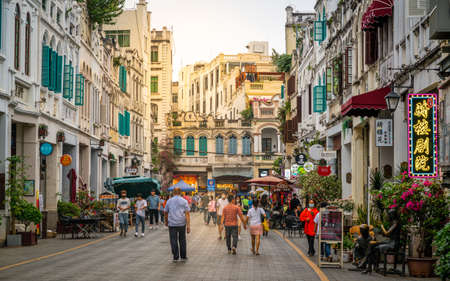 Haikou China, March 21, 2021: Qilou old street aka Zhongshan road with ancient sotto portico buildings and dramatic light in Haikou old town Hainan China Editoriali