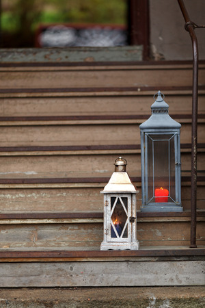 Old wooden stairs and candle light