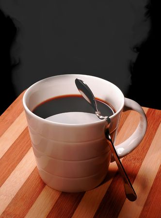 steamy: cup of black steamy coffee