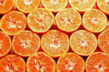ripe orange mandarins cutted in half Stock Photo - 2638874