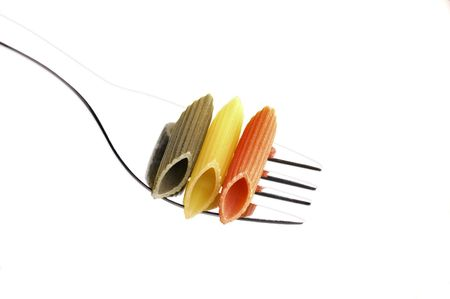 italian penne pasta on a fork ,on white background Stock Photo