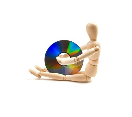 wood mannequin with CD-rom on white background photo