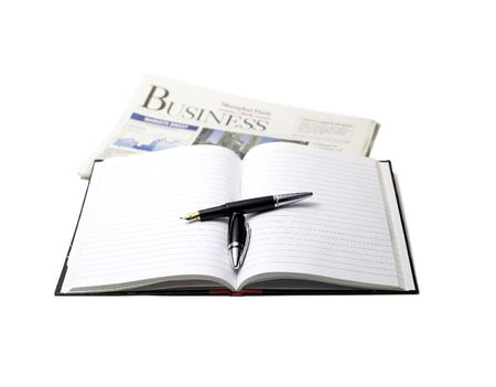 newspaper, pen and notebook on white background photo