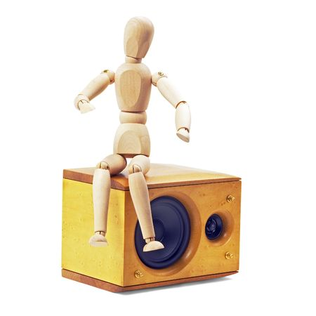 artists dummy: wood mannequin sitting on a speaker isolated on white background