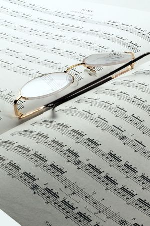 percussion and drums music charts with glasses on top photo