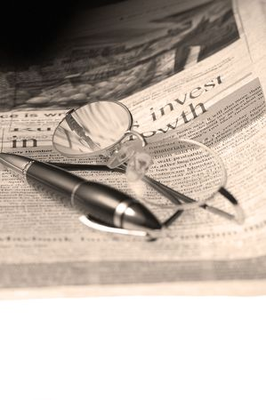 pen and glassesand newspaper over white glass table Stock Photo - 3515585