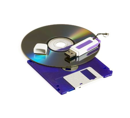 cd rom dvd,floppy disk ,and usb key isolated on white background Stock Photo