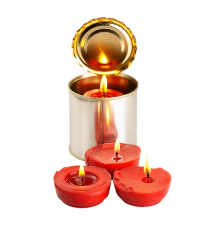 red candle on a tin can ovr white background Stock Photo