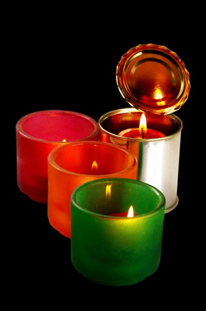 red candle on a tin can over black background Stock Photo - 4006210