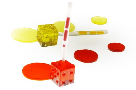 threw: bounch of colorfull translucent dice shaped lollipops backlit on white background