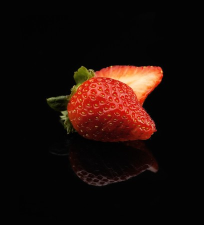 fresh vivid colored strawberry over black background Stock Photo