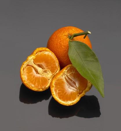 vivid orange tangerine on black reflective surface Stock Photo - 4075968