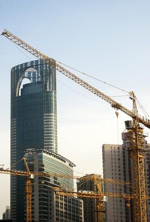 erect: shanghai construction crane over modern building background