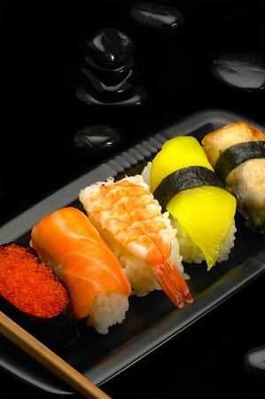 sushi plate: fresh assorted colorfull sushi plate over black