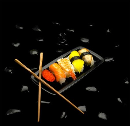 fresh assorted colorfull sushi plate over black Stock Photo - 4625658