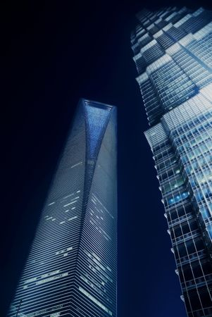 shanghai pudong world financial center and jin mao tower illuminated by night
