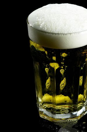 glass of lager  beer over black background Stock Photo - 4850227