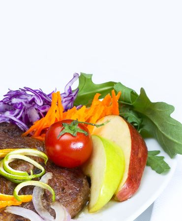 arugola: fresh juicy beef ribeye steak grilled with orange and lemon peel on top and vegetables beside