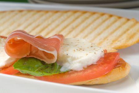 panini sandwich with fresh caprese and parma ham photo