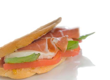 panini sandwich with fresh caprese and parma ham 스톡 사진