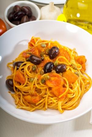 puttanesca: spaghetti pasta with fresh home made puttanesca sauce