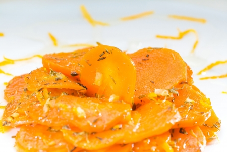 fresh and healthy Honey glazed carrots on a plate with tyme on top photo