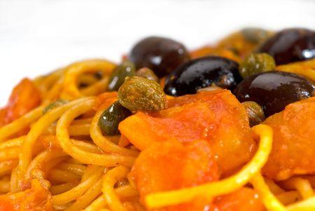 puttanesca: spaghetti italian pasta with fresh home made  puttanesca sauce,extreme closeup,macro