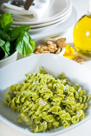 italian fusilli pasta and fresh homemade  pesto sauce photo