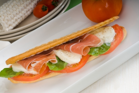 sandwich with fresh caprese and parma ham photo