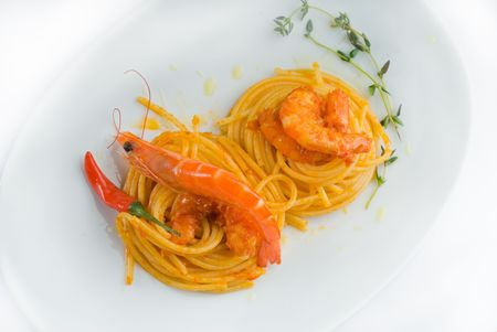 italian spaghetti pasta and fresh spicy shrimps sauce over white photo