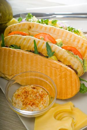 assortment of fresh homemade vegetarian  italian panini sandwich,typical italian snack