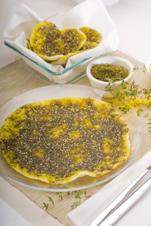 lebanese manouche , lebanese pizza with thyme and sesame seeds, zaatar, and extra virgin olive oil on top