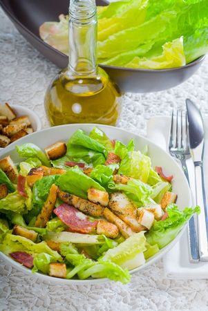 fresh homemade classic ceasar salad ,closeup overa fine embroidery table cover photo