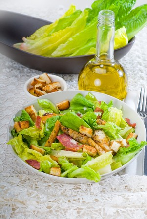 chicken caesar salad: fresh homemade classic ceasar salad ,closeup overa fine embroidery table cover