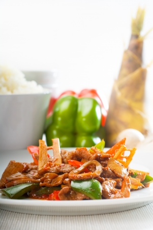 black dish: typical chinese dish,fresh beef stir fried with pepperrs bamboo sprout and mushrooms Stock Photo